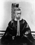 Tokugawa Akitake was born in Komagome, Tokyo, as the 18th son of Tokugawa Nariaki. Initially lord of Aizu, he became lord of Shimizu before his departure for France. Tokugawa Akitake led the Japanese delegation to the 1867 World Fair in Paris, where Japan had its own pavilion. He was designated as special emissary to France and head of the Japanese delegation to the Paris exhibition on November 28, 1866. He stayed in France to pursue studies, but had to return to Japan with the Meiji restoration in 1868. Upon his return, he became Lord of the Mito Clan. In 1876, Tokugawa Akitake went to the United States, as the emissary in charge of the Japanese exhibition at the 1876 World Fair in Philadelphia. He then went to France again for studies. He would return to Japan in 1881, where he served Emperor Meiji.